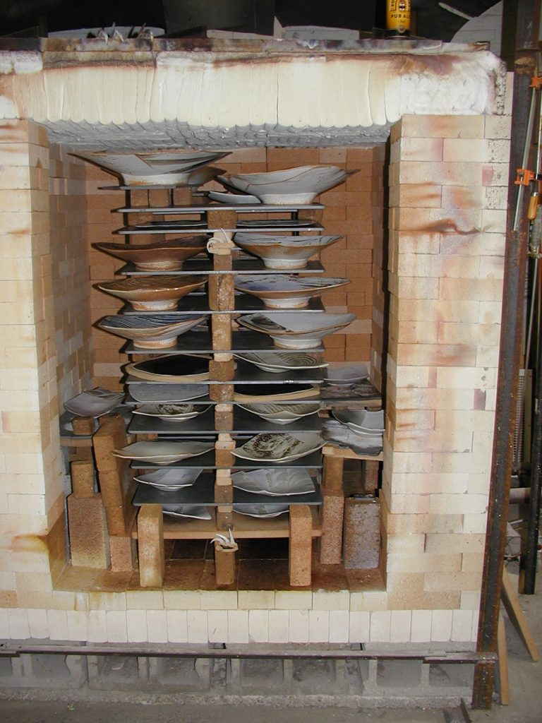 Eric Jensen's gas reduction kiln with Advancer Kiln Shelves and porcelain clay work.