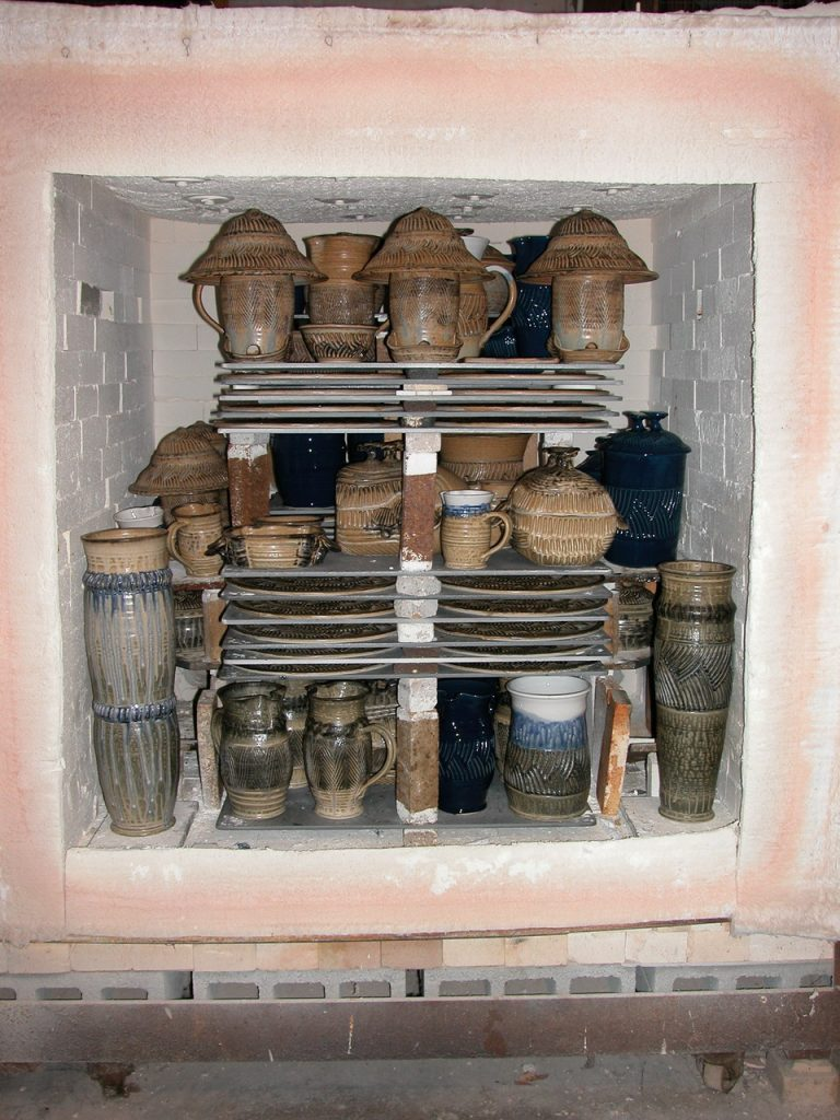 Advancer kiln shelves stacked in a gas kiln