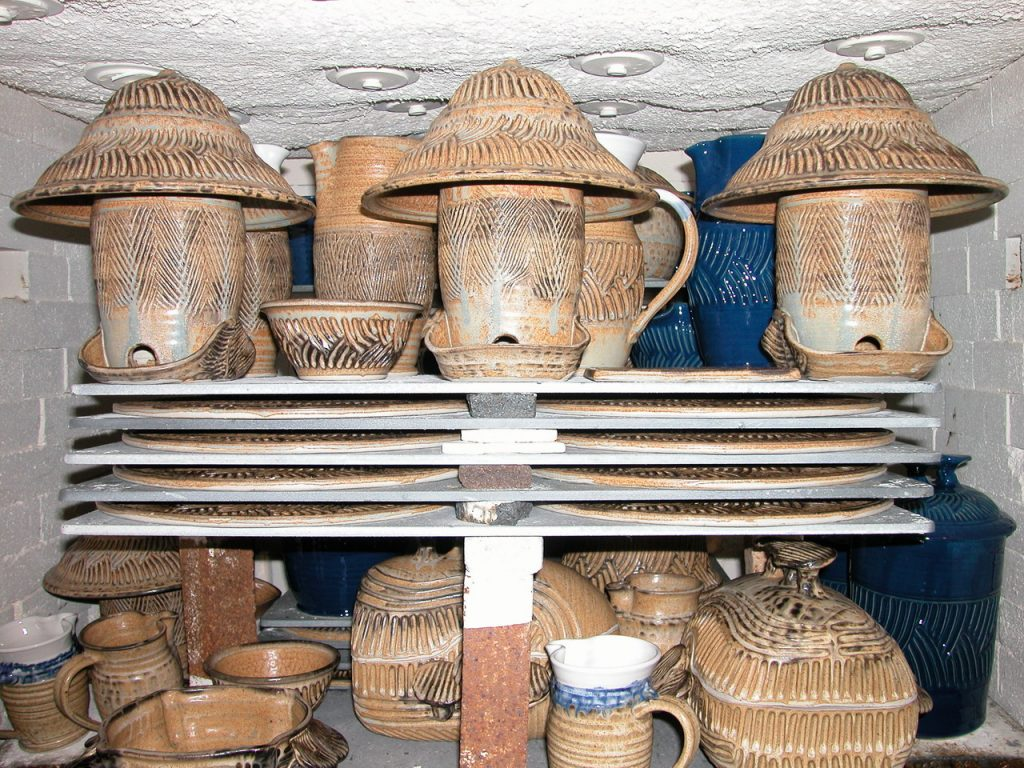 Advancer kiln shelves loaded in a gas kiln